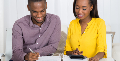 young couple calculating bills