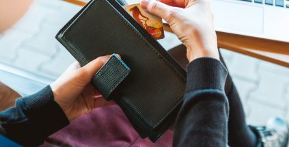 Woman holding wallet with credit card